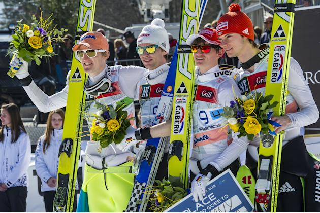 German team's Maximillian Mechler, Severin Freund, Anreas Wank, Richard Freitag pose after taking third placed of the FIS Ski Flying World Cup Team event in Planica on March 17, 2012.   AFP PHOTO / Ju