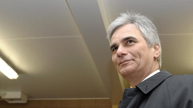 Austrian Chancellor Werner Faymann casts his vote for an army referendum at a polling station in Vienna, Austria, Sunday, Jan. 20, 2013. At issue in this neutral nation of just over 8 million people is whether to keep the present system that relies heavily on conscripts or to go with the European flow and create a professional army, as have 21 of the EU's 26 other members. The present model consists of about 35,000 troops, with about 14,000 professionals and the rest conscripts who serve for six months as well as a 30,000-strong part-time militia. (AP Photo/dapd, Hans Punz)