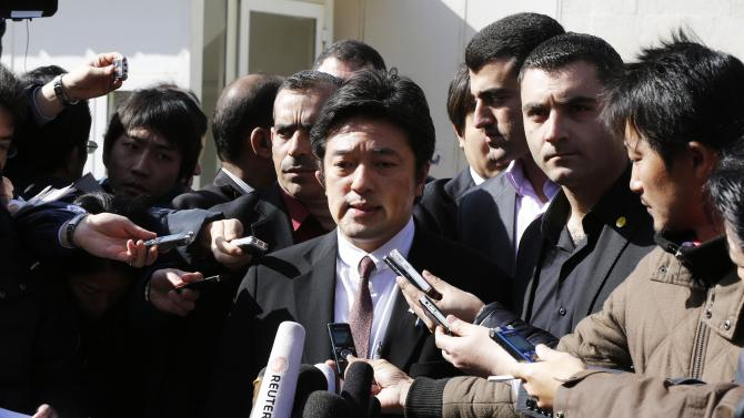 Japan's State Minister for Foreign Affairs Yasuhide Nakayama speaks to the media in Amman