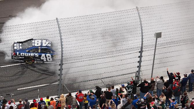 Jimmie Johnson does a burnout on the front stretch at Martinsville Speedway on Sunday, October 28, 2012 in Martinsville, Va., after winning the TUMS Fast Relief 500.  (AP Photo/Steve Sheppard)