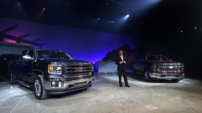 Mark Reuss, General Motors North America President, introduces the 2014 GMC Sierra and Chevrolet Silverado in Pontiac, Mich., Thursday, Dec. 13, 2012.  The revamped Silverados and Sierras are aimed at putting GM back in front. They look similar to the old models, but are a little more aggressive and aerodynamic-looking. (AP Photo/Paul Sancya)