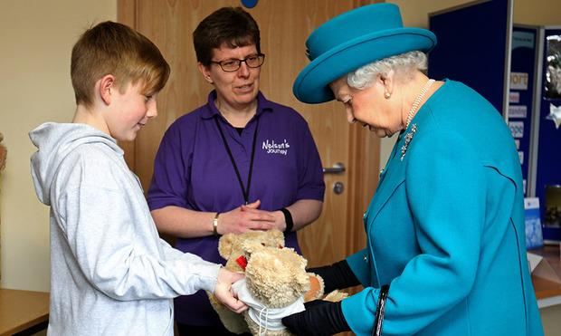 Queen Elizabeth presented with teddy bears for Prince George and Princess Charlotte