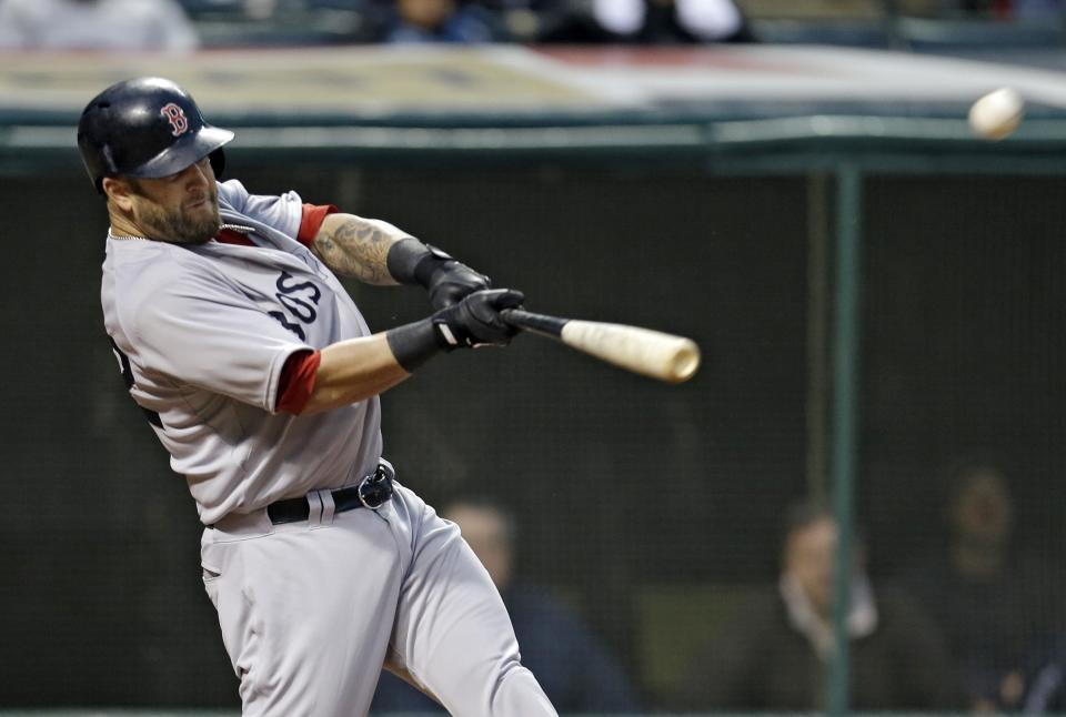 Boston Red Sox's Mike Napoli hits a bases-loaded double off Cleveland Indians starting pitcher Ubaldo Jimenez to drive in three runs in the second inning of a baseball game Tuesday, April 16, 2013, in Cleveland. (AP Photo/Mark Duncan)