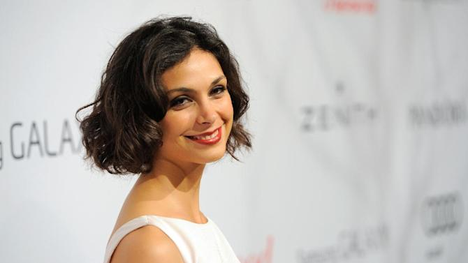 Morena Baccarin arrives at The Hollywood Reporter Nominees' Night at Spago on Monday, Feb. 4, 2013, in Beverly Hills, Calif. (Photo by Chris Pizzello/Invision for The Hollywood Reporter/AP Images)