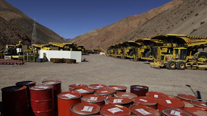 FILE - In this May 23, 2013 file photo, mining machinery and barrels with chemicals are shown in the facilities of Barrick Gold Corp's Pascua-Lama project in northern Chile. A Chilean appeals court ruled against the world's largest gold mining company on Monday, July 15, 2013, favoring Chilean Indians who accuse Barrick Gold Corp. of contaminating their water downstream and creating more doubts about the future of the world's highest gold mine. (AP Photo/Jorge Saenz, File)