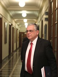 <p>               Greek Prime Minister Lucas Papademos arrives for a cabinet meeting at the Greek Parliament in Athens, on Tuesday, Feb. 28, 2012. Greek lawmakers are to vote on a package of tough salary and pension cuts as part of measures needed to secure the payout of the debt-ridden country's second international package of bailout loans.  (AP Photo/Petros Giannakouris)