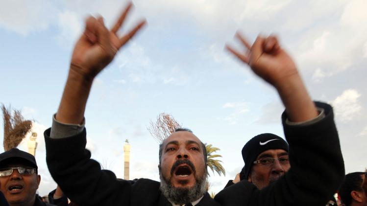 Protesters march against what they said was the extension of the mandate of the National Congress at Martyrs' Square in Tripoli