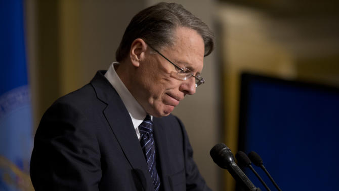 National Rifle Association executive vice president Wayne LaPierre pauses as he makes a statement during a news conference in response to the Connecticut school shooting, on Friday, Dec. 21, 2012 in Washington.  The National Rifle Association broke its silence Friday on last week's shooting rampage at a Connecticut elementary school that left 26 children and staff dead. (AP Photo/ Evan Vucci)
