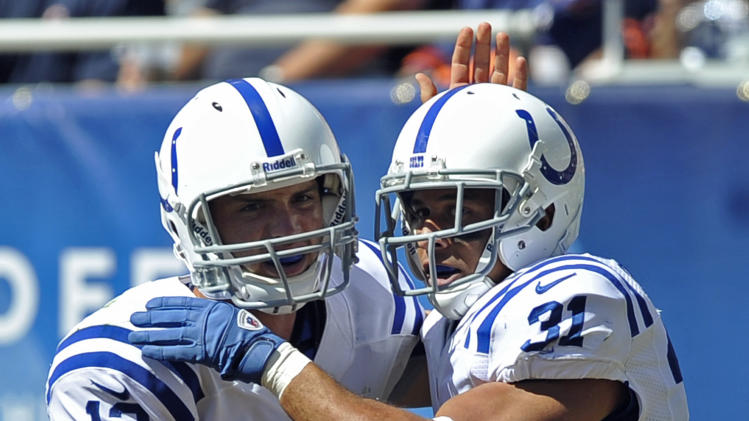 Indianapolis Colts running back Donald Brown (31) celebrates his touchdown run with quarterback Andrew Luck (12) during the first half of an NFL football game against the Chicago Bears in Chicago, Sunday, Sept. 9, 2012. (AP Photo/Jim Prisching)