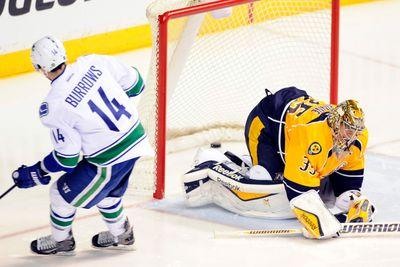 Two Canucks ejected after illegal hit, taunting injured Predators player