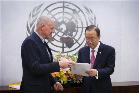 Ake Sellstrom hands his report over to Ban Ki-moon at the United Nations headquarters in