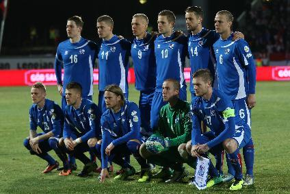 The Iceland team line up ahead of their World Cup qualifying playoff first leg soccer match against Croatia in Reykjavik, Iceland, Friday Nov. 15, 2013