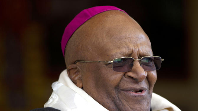 FILE - Archbishop Desmond Tutu, who was awarded the Nobel Peace Prize for his part in fighting apartheid, speaks during a felicitation event for him in Dharmsala, India, in this Feb. 10, 2012 file photo. Archbishop Desmond Tutu in an op-ed piece in the Observer Sunday Sept. 2, 2012 has called for Tony Blair and George Bush to be hauled before an international criminal court and delivered a damning critique of the physical and moral devastation caused by the Iraq war. (AP Photo/Ashwini Bhatia, File)