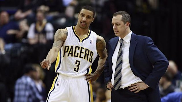 Indiana Pacers guard George Hill (3) talks with Pacers head coach Frank Vogel during the second half of their NBA basketball game versus the Orlando Magic (Reuters)