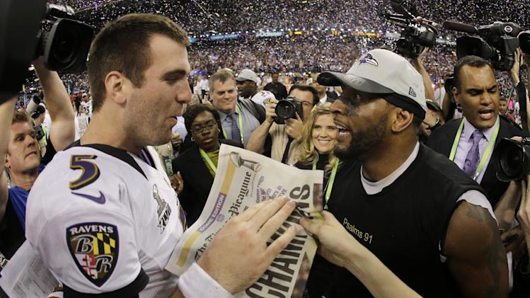 Baltimore Ravens quarterback Joe Flacco, left, and linebacker Ray Lewis celebrates their 34-31 win against the San Francisco 49ers in NFL Super Bowl XLVII football game, Sunday, Feb. 3, 2013, in New Orleans. (AP Photo/Matt Slocum)