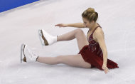 Ashley Wagner falls as she competes during the women's free skate at the U.S. Figure Skating Championships in Boston, Saturday, Jan. 11, 2014. (AP Photo/Elise Amendola)