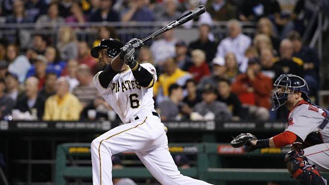 Pittsburgh Pirates' Starling Marte hits a solo home run off Boston Red Sox starting pitcher Anthony Ranaudo during the sixth inning of a baseball game in Pittsburgh Tuesday, Sept. 16, 2014. (AP Photo/Gene J. Puskar)