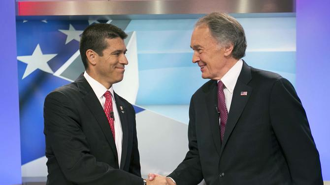 U.S. Senate candidate Republican Gabriel Gomez, left,  shakes hands with Democrat Edward Markey before the debate, Wednesday, June 5, 2013 in Brighton, Mass. Democrat Edward Markey and Republican Gabriel Gomez have clashed in their first debate in Massachusetts special U.S. Senate election, with each candidate trying to portray the other as out of step with ordinary citizens. (AP Photo/The Boston Globe, Yoon S. Byun, Pool)