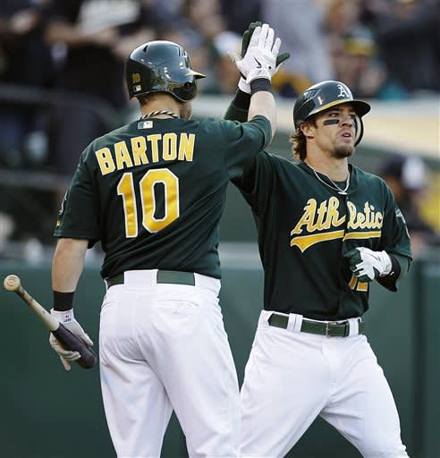 McCarthy strikes out 10, leads A's past Tigers 3-1