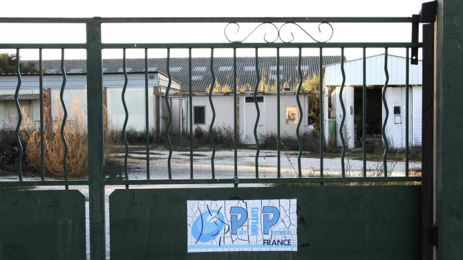 FOR STORY BRITAIN COSMETIC SURGERY - FILE - In this Friday, Jan. 6, 2012, file photo showing the closed gate of the entrance to Poly Implant Prothese, PIP factory in La Seyne-sur-Mer, southern France. An independent expert group released a report Wednesday April 24, 2013, which slammed Britain's cosmetic surgery industry for not protecting patients adequately and is calling for stricter controls in the aftermath of a breast implant scandal in Europe last year that left tens of thousands of women with cheap silicone implants which are allegedly prone to ruptures. The expert group, commissioned by the U.K. Department of Health, also called for the creation of a registry of implants and other medical devices. (AP Photo/Claude Paris, File)