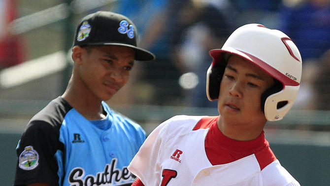 Tokyo's Noriatsu Osaka, right, rounds the  bases past Goodlettsville, Tenn., second baseman Lorenzo Butler after hitting a solo home run in the second inning of the Little League World Series championship baseball game in South Williamsport, Pa., Sunday, Aug. 26, 2012. (AP Photo/Gene J. Puskar)