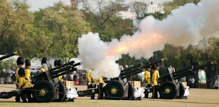 Thai royal guards fire artillery to salute during the royal cremation for late Princess Bejaratana Rajasuda Sirisobhabannavadi at Sanam Luang in Bangkok on April 9, 2012