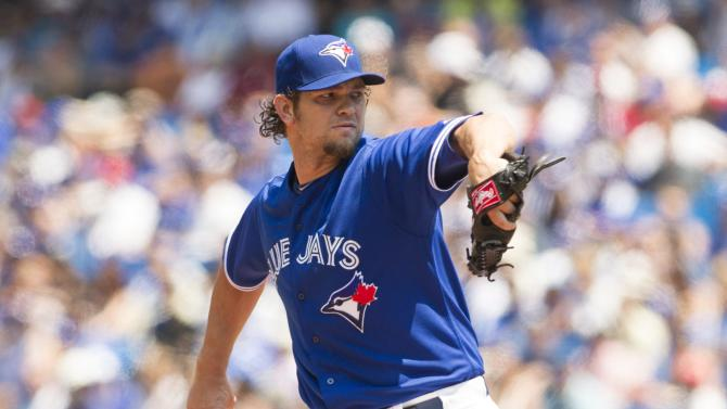 Toronto Blue pitcher Jays Josh Johnson works against the Baltimore Orioles during first-inning baseball game action in Toronto, Sunday June 23, 2013. (AP Photo/The Canadian Press, Chris Young)