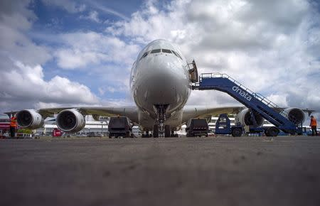 An Airbus Industrie A380 aircraft stands parked at the 2014 Farnborough International Airshow in Farnborough, southern England