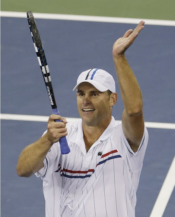 Andy Roddick reacts after winning his match against Australia's Bernard Tomic in the third round of play at the 2012 US Open tennis tournament,  Friday, Aug. 31, 2012, in New York. (AP Photo/Mike Grol