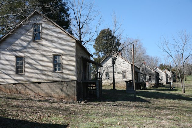 "This undated image provided by VisitNC.com shows the abandoned Henry River Mill Village in Hildebran, N.C., where scenes from ""The Hunger Games"" were shot. The house on the left was outfitted as the E"