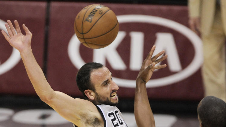 San Antonio Spurs' Manu Ginobili, left, of Argentina, falls after tangling with Memphis Grizzlies' Darrell Arthur during the first half of Game 1 of the Western Conference final NBA basketball playoff series Sunday, May 19, 2013, in San Antonio. (AP Photo/Darren Abate)