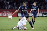 Paris Saint-Germain&#39;s forward Zlatan Ibrahimovic (top) fights for the ball with Lorient&#39;s defender Lucas Mareque during their French L1 football match at the Parc des Princes stadium in Paris. Paris Saint Germain thanked a double from new signing Zlatan Ibrahimovic on Saturday - including a last-gasp penalty - as they could only draw 2-2 against lowly Lorient in their opening French league match