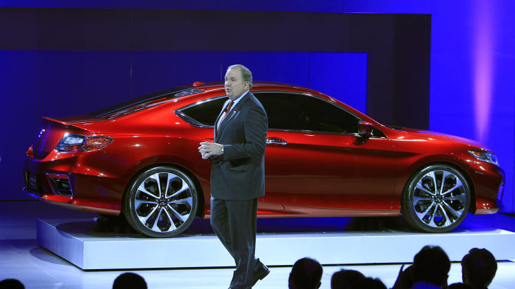 John Mendel, executive vice president of sales for American Honda unveils the 2013 Honda Accord Coupe concept during the North American International Auto Show in Detroit, Tuesday, Jan. 10, 2012. (AP Photo/Carlos Osorio)