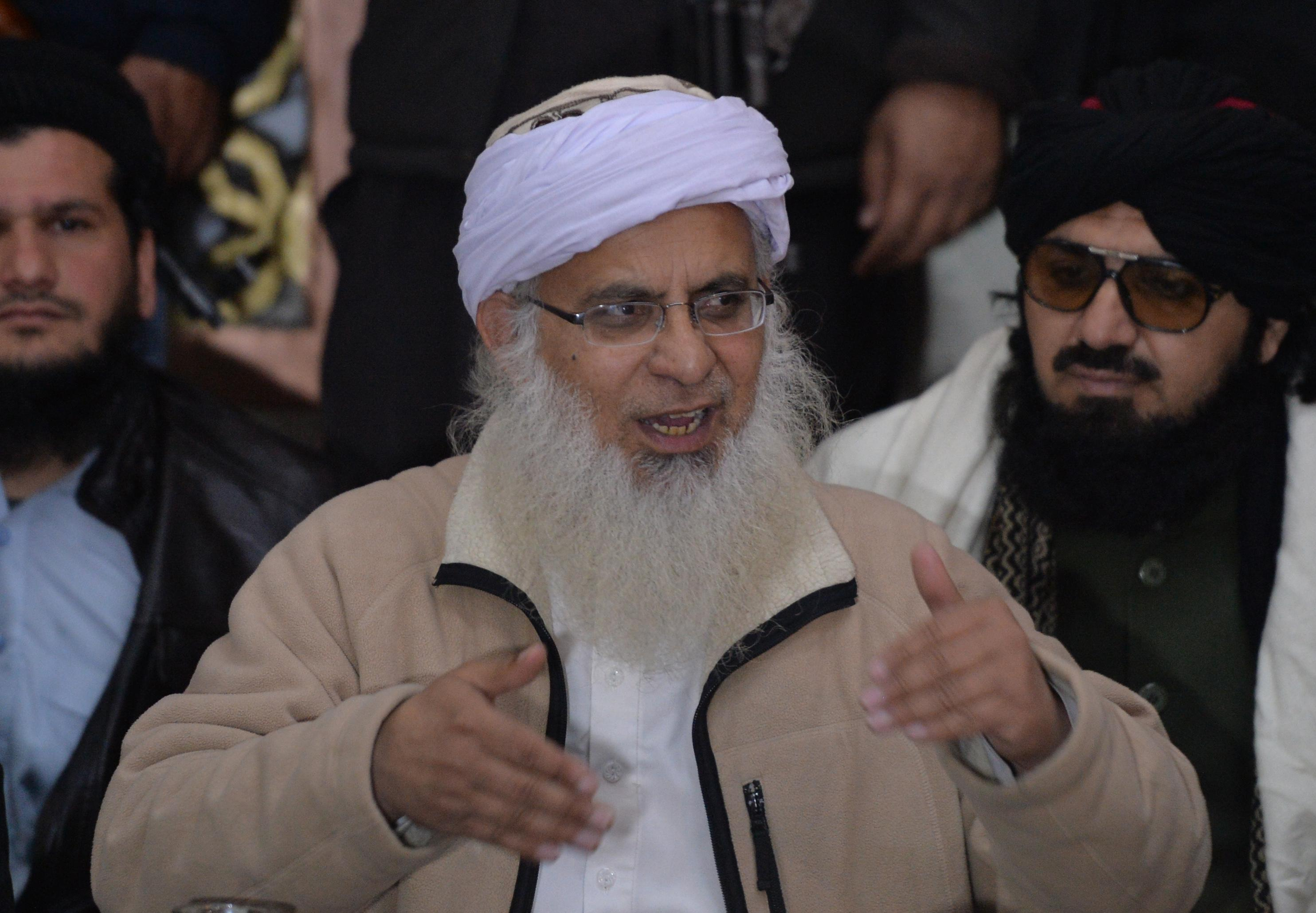 Pakistan court issues arrest warrant for hardline cleric