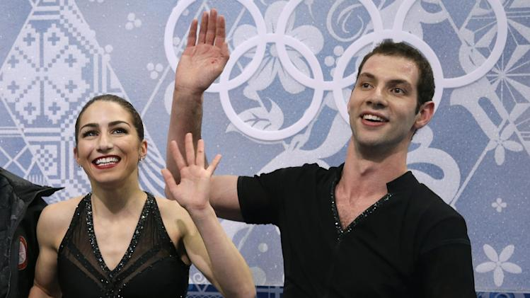 Marissa Castelli and Simon Shnapir of the United States wait in the results area after competing in the pairs short program figure skating competition at the Iceberg Skating Palace during the 2014 Winter Olympics, Tuesday, Feb. 11, 2014, in Sochi, Russia