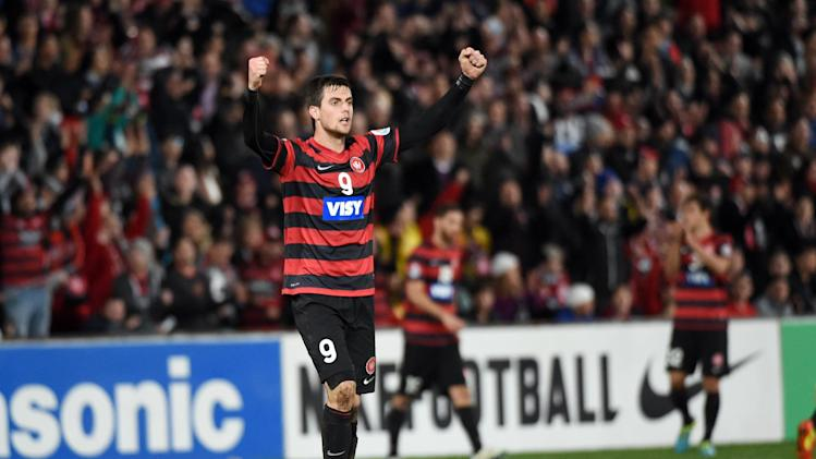 Western Sydney Wanderers' Tomi Juric celebrates after they defeat Guangzhou Evergrande in the AFC Champions League quarter-final match in Sydney on August 20, 2014