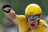 Britian's Bradley Wiggins celebrates at the end of the individual time-trial and 19th stage of the 2012 Tour de France cycling race. Wiggins virtually secured his maiden Tour de France victory after winning the penultimate stage-time trial of the race