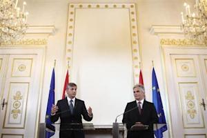 Austrian Vice Chancellor Spindelegger of the OeVP and Chancellor Faymann of the SPOe address the media after a cabinet meeting following parliamentary elections in Vienna