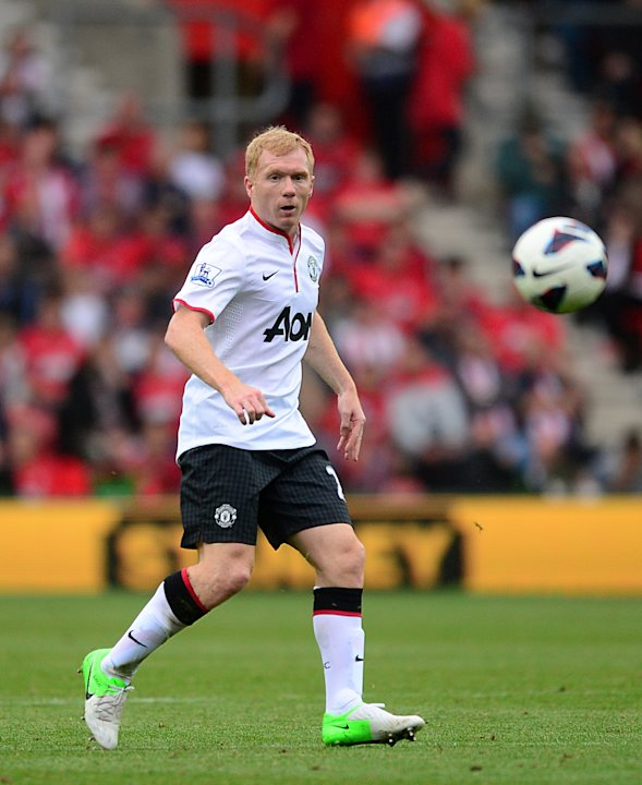 Veteran midfielder Paul Scholes has welcomed the competition for places at Manchester United