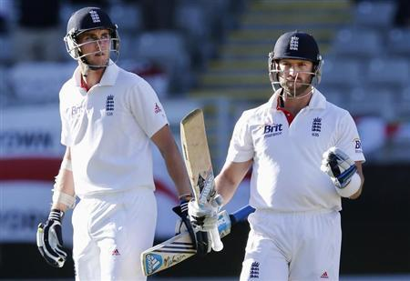 England's Prior celebrates next to Broad after scoring 100 runs against New Zealand in Auckland