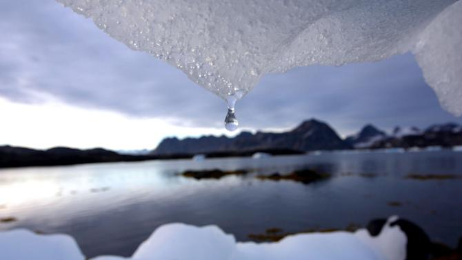 In this Tuesday Aug, 16, 2005 file photo an iceberg melts in Kulusuk, Greenland near the arctic circle. Scientists who are fine-tuning a landmark U.N. report on climate change are struggling to explain why global warming appears to have slowed down in the past 15 years even as greenhouse gas emissions keep rising. Leaked documents show there is widespread disagreement among governments over how to address the contentious issue in Sept. 23-26 stock-taking report by the Intergovernmental Panel on Climate Change. (AP Photo/John McConnico, File)