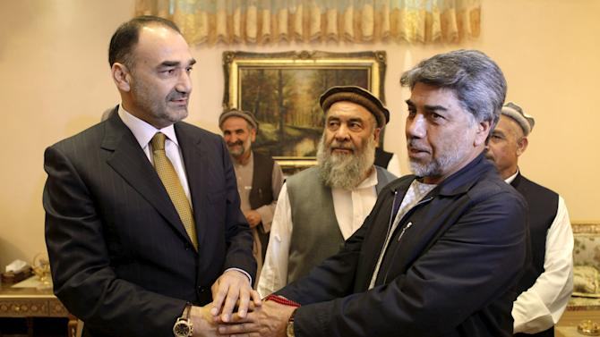 Governor of Mazar-i-Sharif Atta Mohammad Noor shakes hands with tribe elders in Mazar-i-Sharif