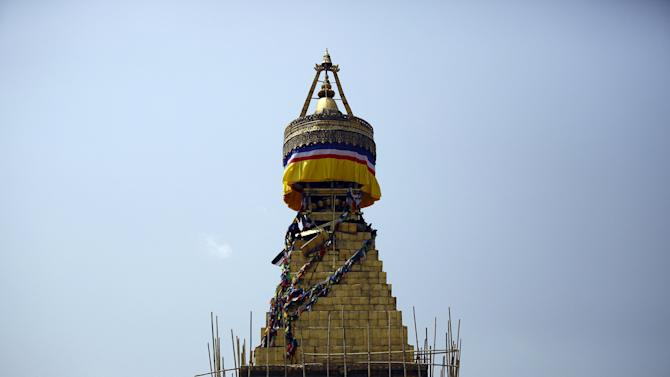 Labourers work to fix the damaged Boudhanath Stupa, a month after the April 25 earthquake in Kathmandu
