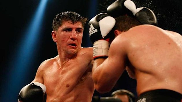 Marco Huck punches Firat Arslan during the WBO Cruiserweigh championship fight (Reuters)