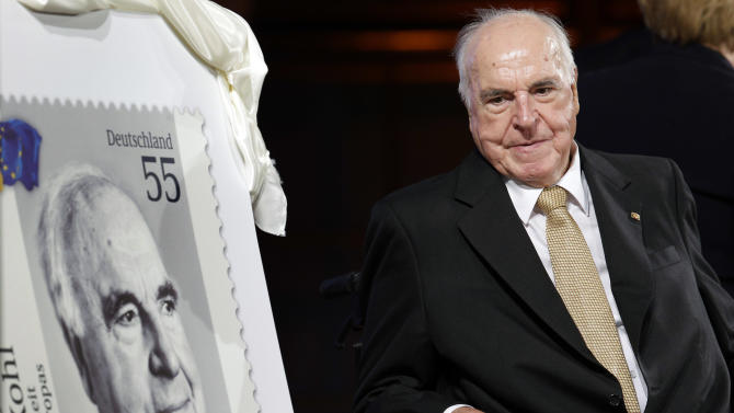Former German Chancellor Helmut Kohl is pictured beside a stamp showing himself during a reception of the Konrad-Adenauer Foundation in Berlin, Germany, Thursday, Sept. 27, 2012. The Foundation will celebrate the 30th anniversary of the start of Kohl's chancellorship on Oct. 1, 1982. (AP Photo/Michael Sohn)