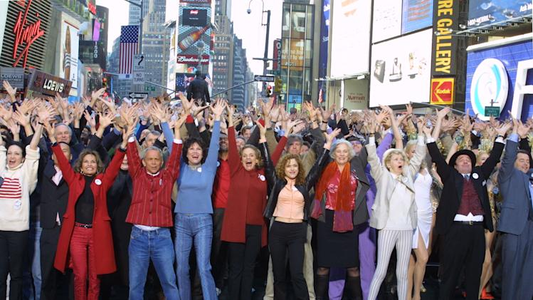 "FILE - This Sept. 28, 2001 file photo shows hundreds of Broadway cast members, including front row, from left, Bebe Neuwirth, Susan Lucci, Joel Grey, Michele Lee, Valeria Harper, Bernadette Peters, Betty Buckley, Elaine Stritch, Nathan Lane and Matthew Broderick. singing ""New York, New York"" for a public service announcement shot in New York's Times Square. The Actors' Equity Association, which has begun a yearlong celebration of its centennial, will get a Special Tony in recognition of their work negotiating wages, working conditions and benefits for stage performers and crew members. (AP Photo/Diane Bondareff, file)"