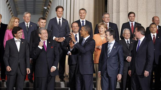 President Barack Obama, center, talks about American football to European world leaders during the NATO family photo at Soldier Field at the NATO Summit in Chicago, Sunday, May 20, 2012. (AP Photo/Pablo Martinez Monsivais)