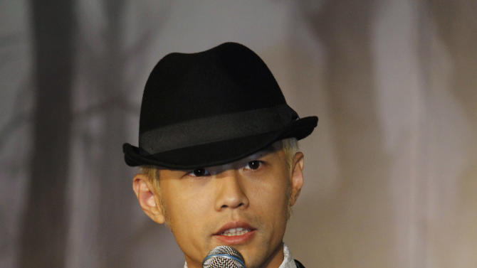 "Taiwan performer Jay Chou answers a reporter's questions during a press conference announcing his new CD ""Opus 12"" in Taipei, Taiwan, Thursday, Dec. 27, 2012. (AP Photo/Wally Santana)"