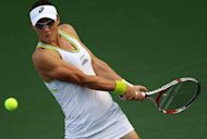 Australian tennis player Samantha Stosur returns the ball to Lucie Safarova of the Czech Republic during their Dubai WTA Open tennis match in the Gulf emirate. Stosur appears to have her best chance to win a first title since the US Open after reaching the quarter-finals of the Dubai Open on Wednesday