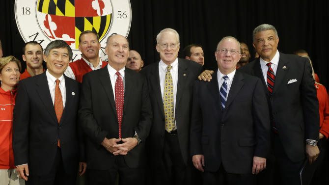 University of Maryland President Wallace Loh, from left,  Big Ten Commissioner James Delany, University System of Maryland Chancellor Brit Kirwin, University System of Maryland Board of Regents Chairman James Shea and Maryland Athletic Director Kevin Anderson pose after a news conference to announce Maryland's decision to move to the Big Ten in College Park, Md., Monday, Nov. 19, 2012. Maryland is joining the Big Ten, leaving the Atlantic Coast Conference in a shocker of a move in the world of conference realignment. (AP Photo/Patrick Semansky)